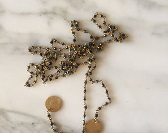 Silver rosary with tags.