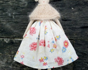 Handmade doll with a skirt made from a beautiful piece of french vintage fabric