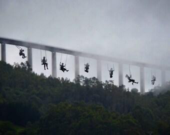 Illustration of people swinging on bridge photography.