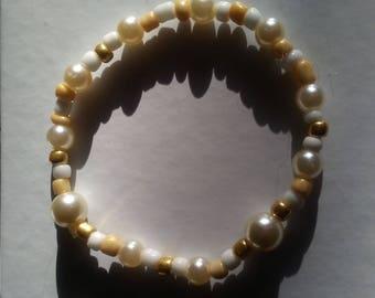 Tan and white bracelet