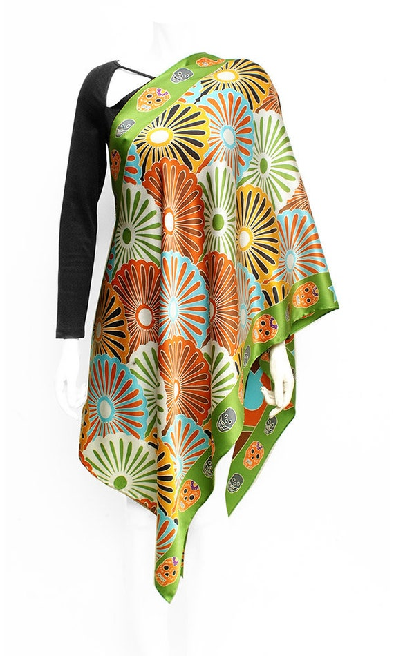 Graphic pattern long silk scarf with skulls on green background
