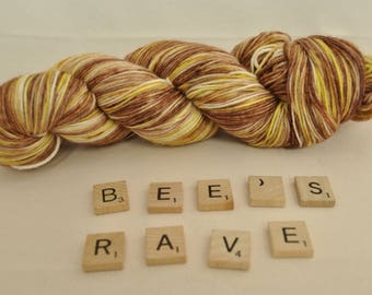"Hand-dyed yarn, ""Bee's Rave"" variegated, soft and squishy yarn. Great for socks or shawls. 80/20 Superwash wool/Nylon"