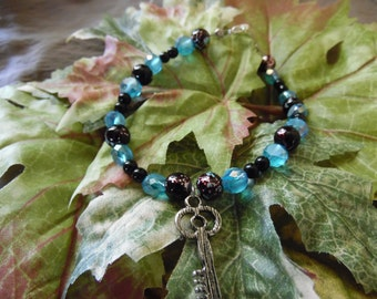 Handmade Beaded Bracelet Blue And Black With Charm 9 Inches