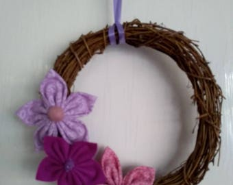 Rattan garland/wreath decorated with handsewn felt & fabric flowers