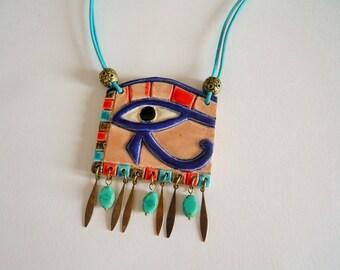 Egyptian theme ceramic pendant: handmade eye of Horus