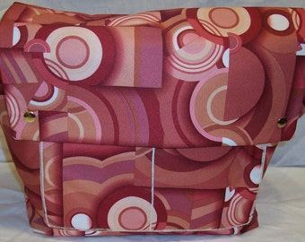 Kate Messenger in Red and Cream Retro Deco Print Thin Vinyl and a cream canvas lining