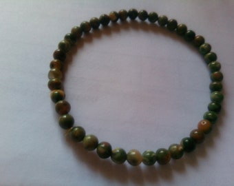 Rainforest Rhyolite for a wrist of 6&1/4 inches stones are 4mm