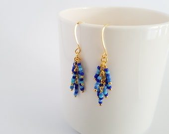 Blue beads, wire wrapped, gold plated cluster earrings.