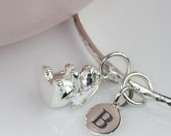Solid Silver Bunny Rabbit Charm on a Solid Silver Hammered Bangle Personalised with a Solid Silver Stamped Initial Charm