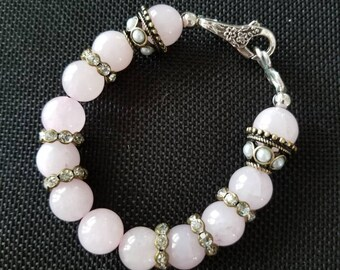 Smooth pink bauble bead bracelet with rhinestone sparkle