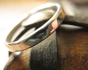 Sterling silver ring faceted band