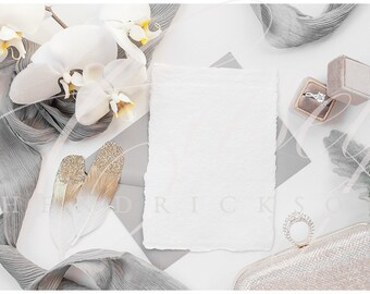 Gray, Gold, White deckled edge stationery mockup for wedding stock photo with orchids