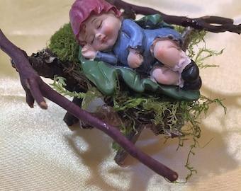 Fairy Child Asleep in Cradle