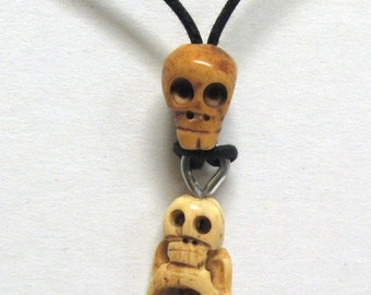 Unusual Handmade Bone Crouching Skeleton on a Bone Skull Necklace 01
