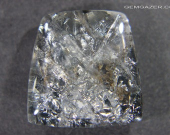 Quartz cabochon with metallic Pyrolusite inclusions, Brazil.  20.89 carats.