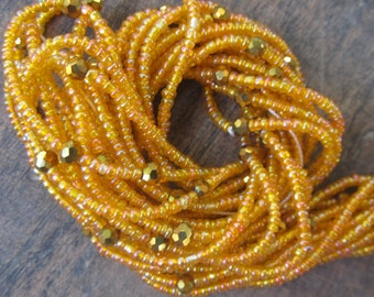 Red and orange custom made waist beads with crystals stranded on beading wire, read item details and leave size