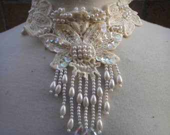 Cute Venice beaded applique ivory   color 9 inches wide at the neck 5 inches long from the center down
