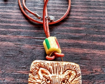 Hand sculpted lion pendant/necklace on leather cord with stone bead and stone bead closure