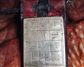 Tuareg Gri Gri Protection AMULET on dark Leather with TIFINAGH signs with Leather Cord
