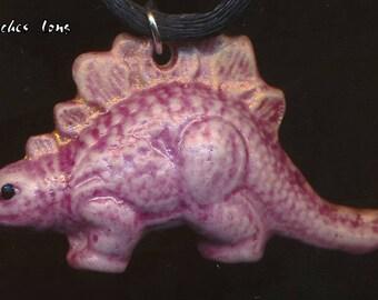 Pink Porcelain Dinosaur Necklace....Stegosaurus perhaps??