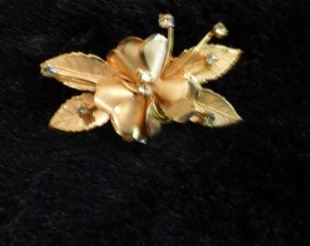 Floral brooch with yellow stones