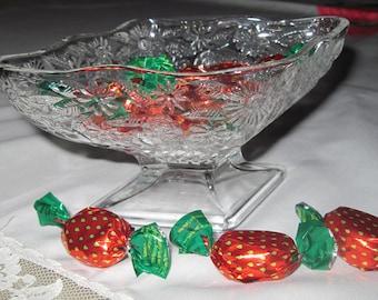 Diamond-shaped cut glass candy dish