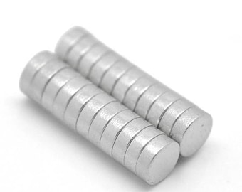 Set of 2 magnets magnetic 8 X 3 mm round drops.