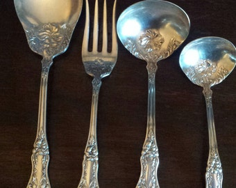 1914 Pansy Silverplate Serving Set by S.L. & G. H. R. Co. 4 piece set: Meat fork, Gravy Ladle, Cream Ladle and Casserole Spoon