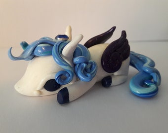 Cute pegasus sleepy pony sculpture