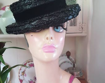 1930s cellophane straw boater black hat with a velvet band tied  in a bow details the back