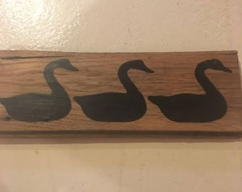 Handmade painted geese sign