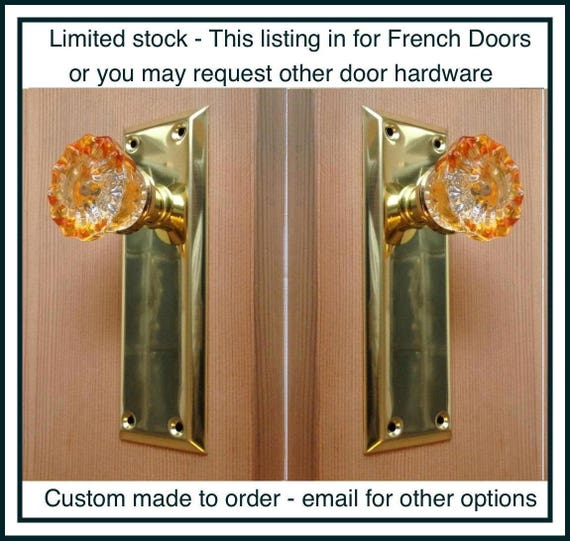 Crystal Amber Door Knobs with Tall Polished Brass Plate.