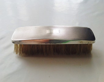 Silver clothes vanity brush