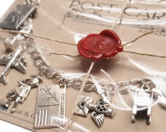 Snail Mail Charm Bracelet w/ mailbox, dove, love letter, Mr. Zip, postcard, airplane, globe, typewriter, postage stamp, pen and more charms
