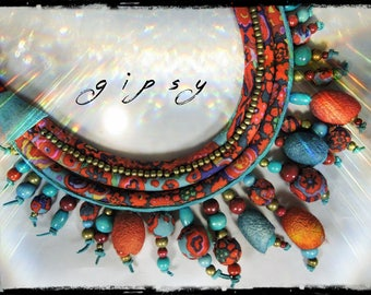Gypsy - 3 strands - fabric necklace multicolor predominantly red, Garnet and blue oil, wood beads, balls of cotton and cocoon