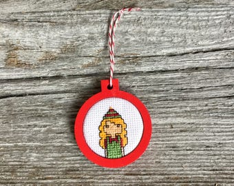 Santa's elf cross stitch Christmas tree ornament in red laser cut birch wood frame by Canadian Stitchery