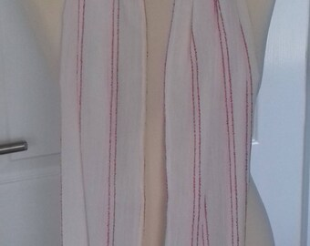 White fashion scarf with pink stripes and pompom trim