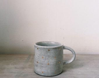 White mug with gold polka dots