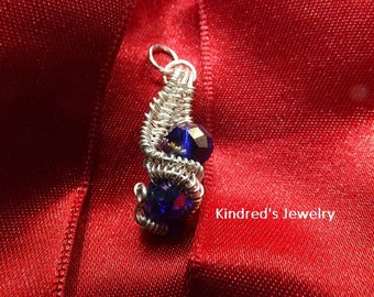 Wire Wrapped Colbalt Blue Crystal Beads.