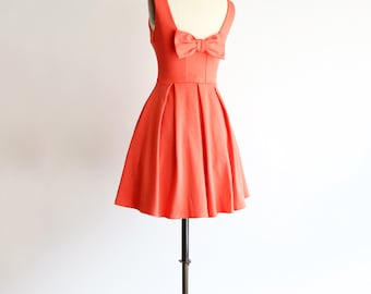 JANUARY | Coral bridesmaid dress with bow. vintage inspired cocktail dress. pleated skirt party dress. retro mod coral bridesmaids dress