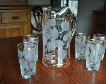 5 - Glass Tumbles and A Glass Pitcher with Etched Morning Glories and Vines with Leaves