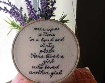 Once upon a time in a loud and dirty place there lived a girl who loved another girl - Hand Embroidered Hoop Art - poem