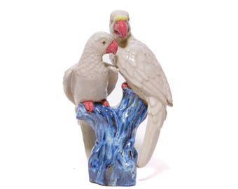 Glazed sculpture of a pair of parrots