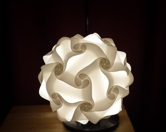 Puzzle light with a base