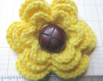 Irish crochet flower brooch in yellow wool with vintage football button centre