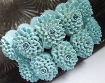Vintage carved celluloid blue hinged rhinestone clamper bracelet Featherweight Bubbleite Featherlite floral chrysanthemums chunky large