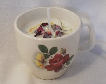 Soy candle in vintage espresso cup with rose petal and marigold topping with glitter sprinkles