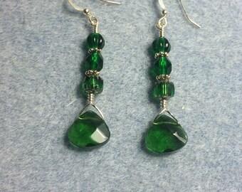 Emerald green briolette dangle earrings adorned with emerald green Czech glass beads.