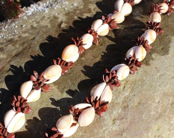 A vintage shell and seed long necklace