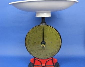 Stunning antique weighing scales. Salters Improved Family Scale number 50. 28lbs. Red and Black cast iron with gorgeous brass face.